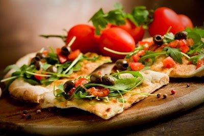 Belegen Sie mal eine Pizza mit Rucola - das schmeckt wunderbar