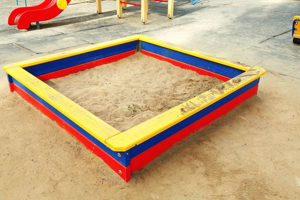 Colorful wooden sandpit