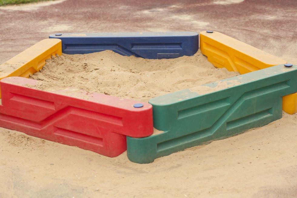 Sandpit with plastic edging