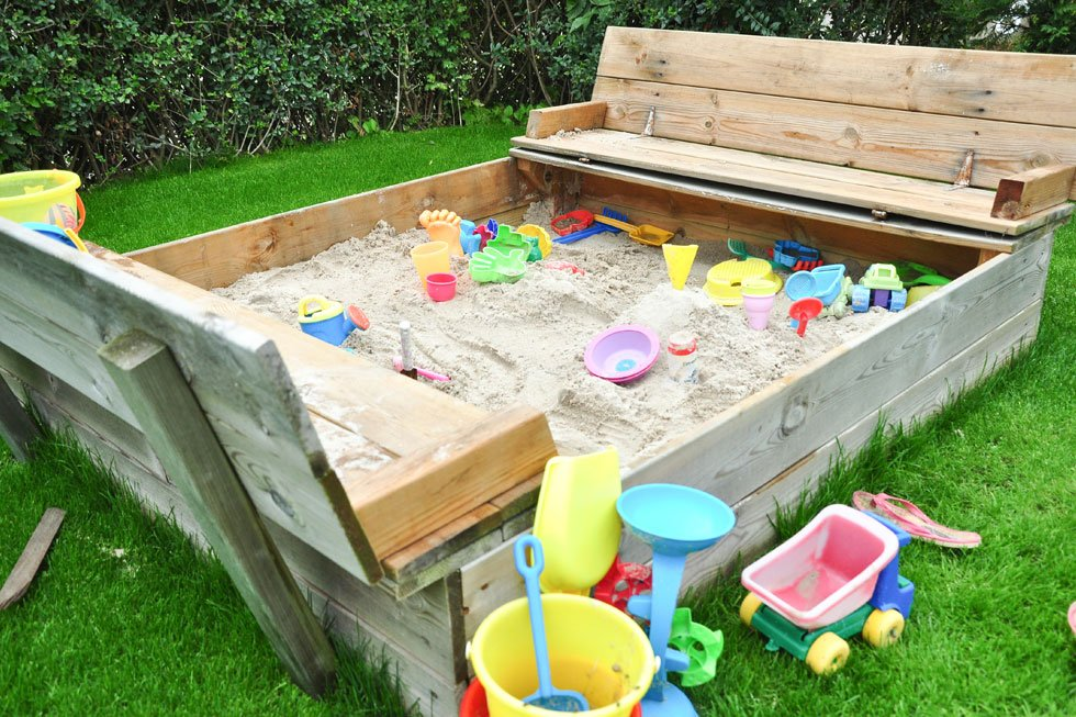 Sandpit with benches and cover